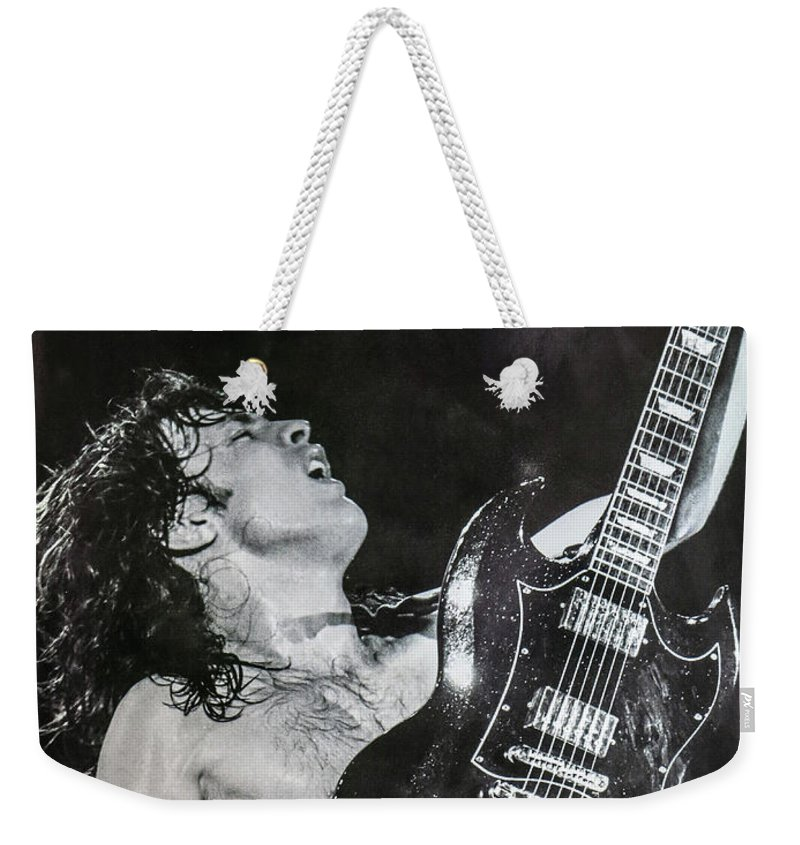 Angus Young Weekender Tote Bag featuring the photograph Angus Young 1981 ACDC by Leigh Henningham