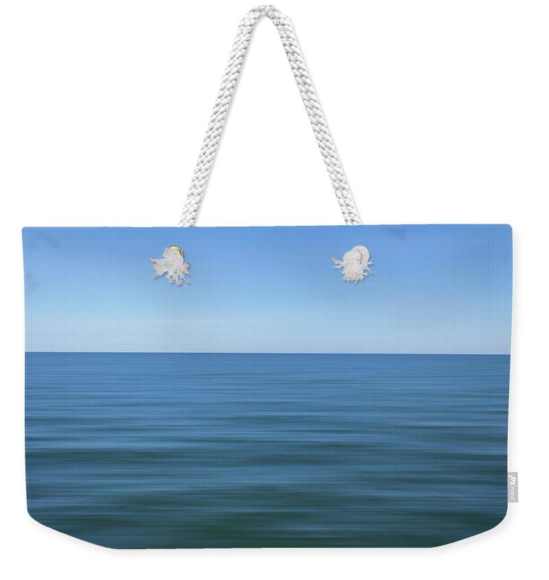 Balticsea Weekender Tote Bag featuring the photograph Baltic sea by Maria Rzeszotarska