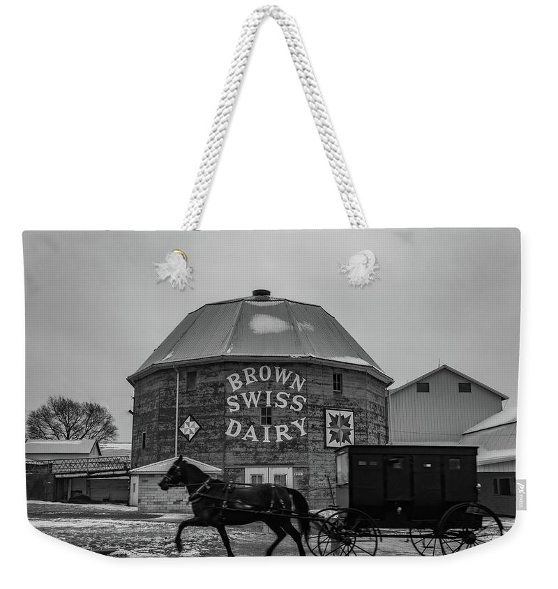 Landscape Weekender Tote Bag featuring the photograph Brown Swiss Dairy Round Barn In Black And White by Scott Smith