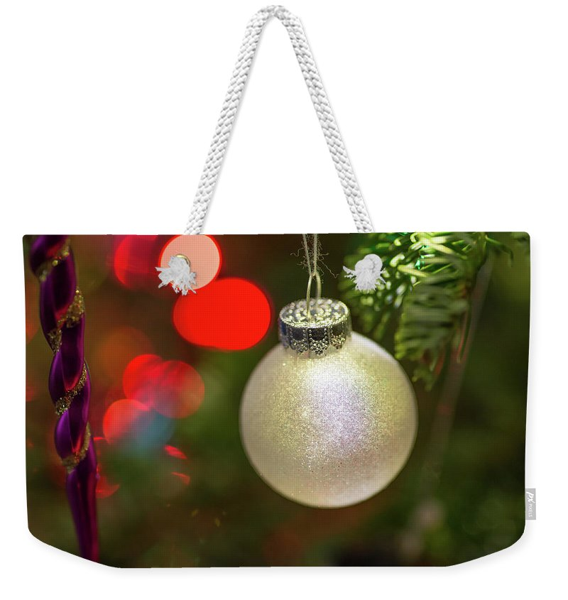 Ball Weekender Tote Bag featuring the photograph Christmas Ornaments With Bokeh Background by Ognian Setchanov