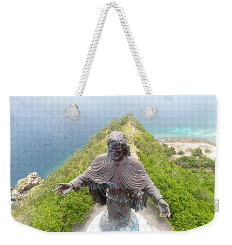 Adventure Weekender Tote Bag featuring the photograph Cristo Rei of Dili statue of Jesus by Brthrjhn2099
