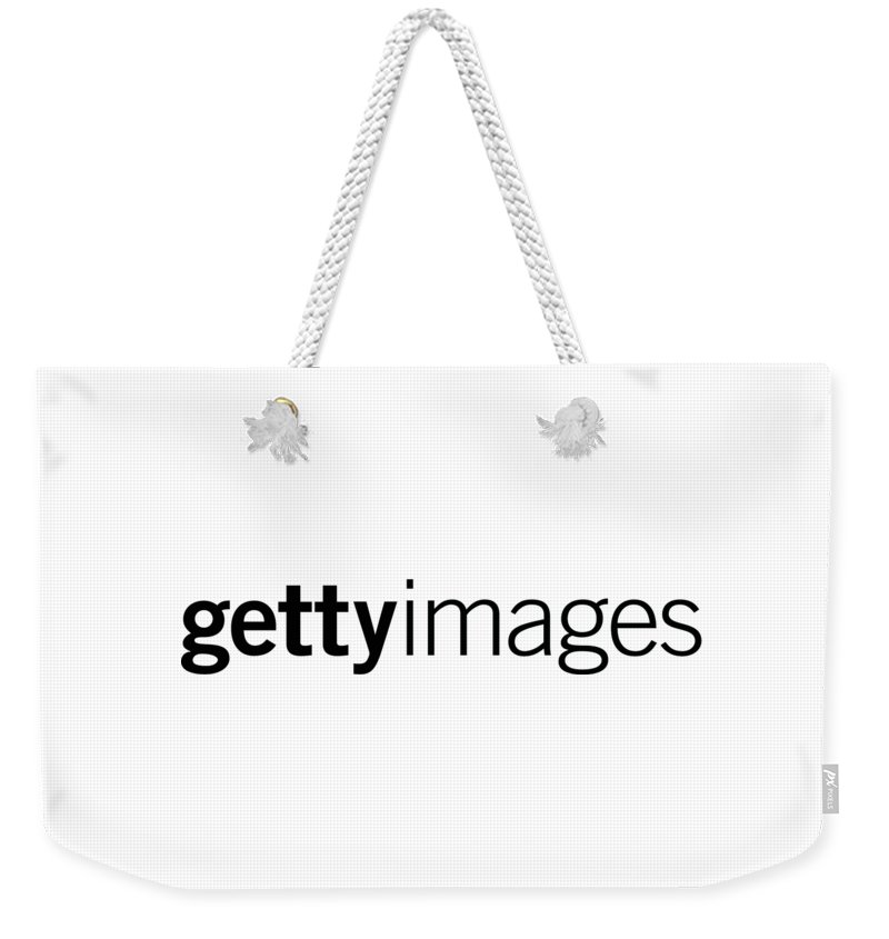 Getty Images Logo Weekender Tote Bag featuring the digital art Getty Images Logo by Getty Images