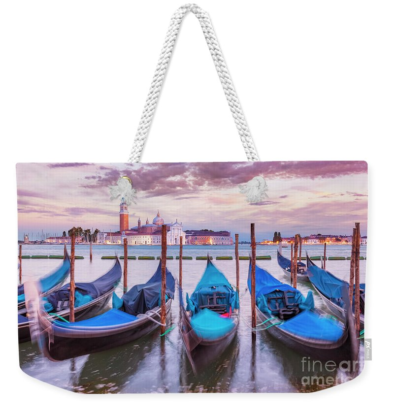Gondolas Weekender Tote Bag featuring the photograph Gondolas On The Venice Lagoon, Italy by Neale And Judith Clark