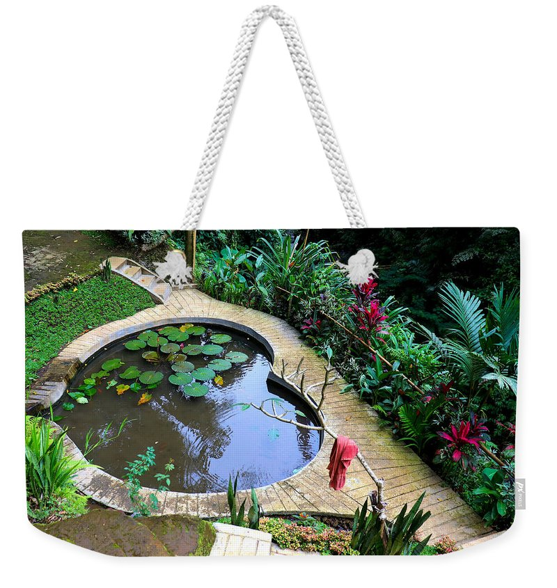 Heart Weekender Tote Bag featuring the digital art Heart-shaped pond with water lilies by Worldvibes1