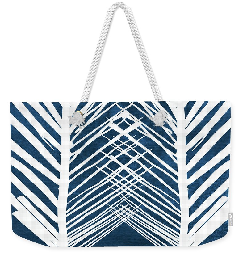 Leaves Weekender Tote Bag featuring the painting Indigo and White Leaves- Abstract Art by Linda Woods