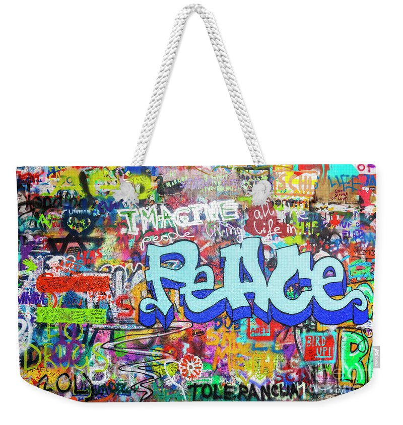 John Lennon Peace Wall Weekender Tote Bag featuring the photograph Lennon Wall Graffiti, Prague by Neale And Judith Clark