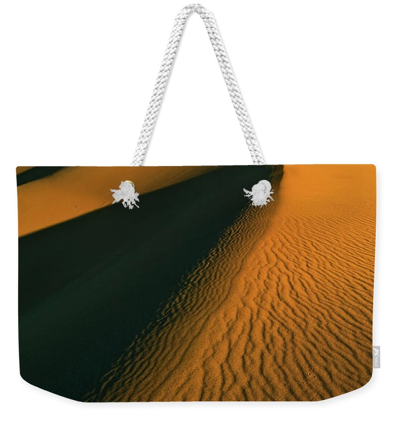 Mesquite Flats Sand Dunes Weekender Tote Bag featuring the photograph Mesquite Flats Sand Dunes, Death Valley, California by Neale And Judith Clark