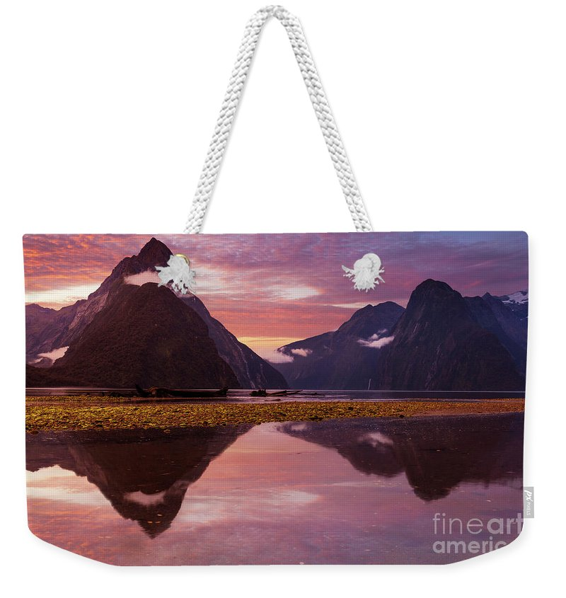 Sunset Weekender Tote Bag featuring the photograph Milford Sound Sunset, New Zealand by Neale And Judith Clark