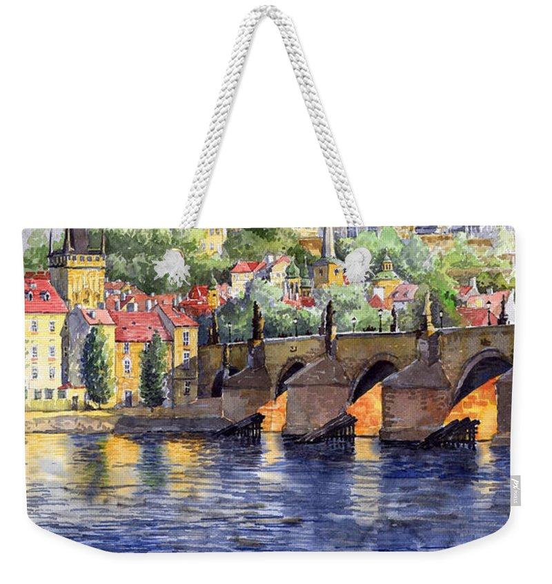 Watercolour Watercolor Prague Praha Cityscape Castle Old City Hous Bridge Weekender Tote Bag featuring the painting Prague Castle with the Vltava River 1 by Yuriy Shevchuk