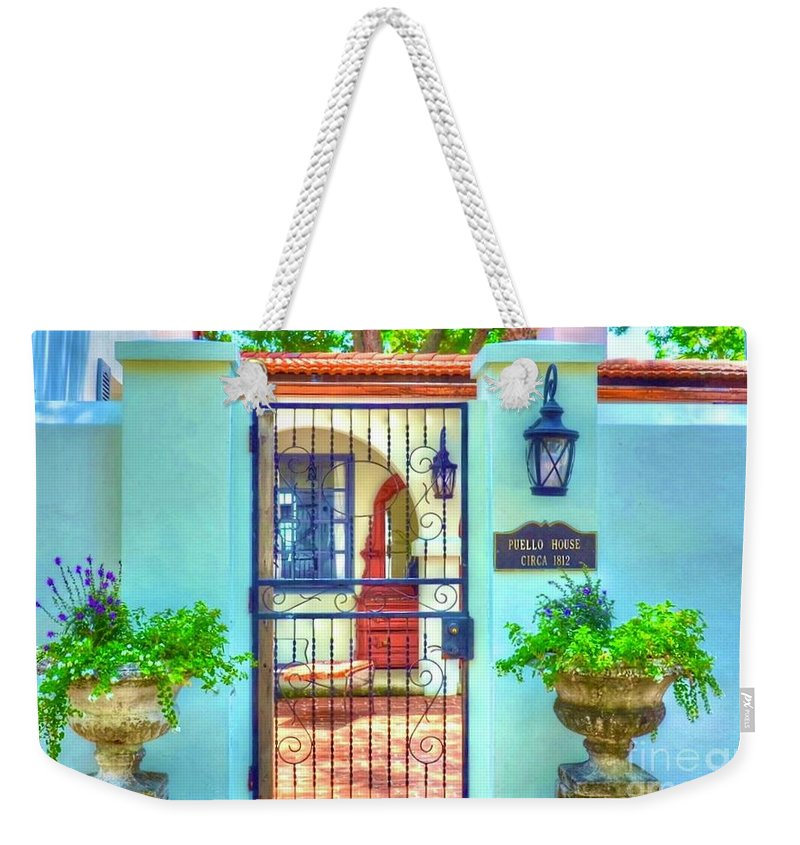 Gate Weekender Tote Bag featuring the photograph Puello House by Debbi Granruth