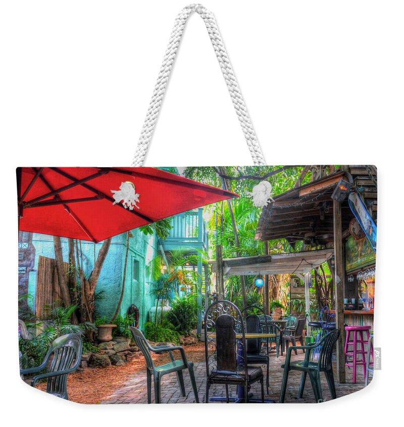 Umbrella Weekender Tote Bag featuring the photograph Red Umbrella by Debbi Granruth