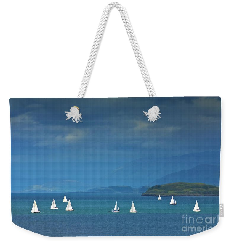 Stormy Weather Weekender Tote Bag featuring the photograph Sailing Boats Off The Island Of Mull, Scotland by Neale And Judith Clark