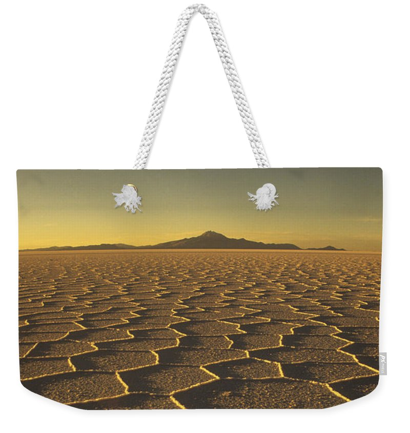 Bolivia Weekender Tote Bag featuring the photograph Salar de Uyuni and Tunupa volcano by James Brunker