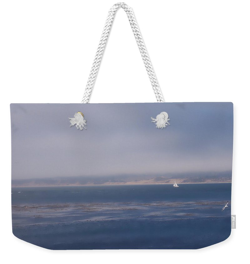 Sail Weekender Tote Bag featuring the photograph Solo Sail in Monterey Bay by Pharris Art