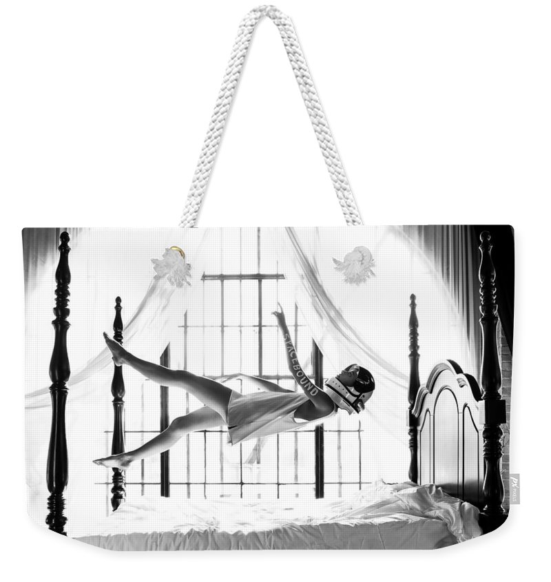 Weekender Tote Bag featuring the photograph Spacebound by Brendan North