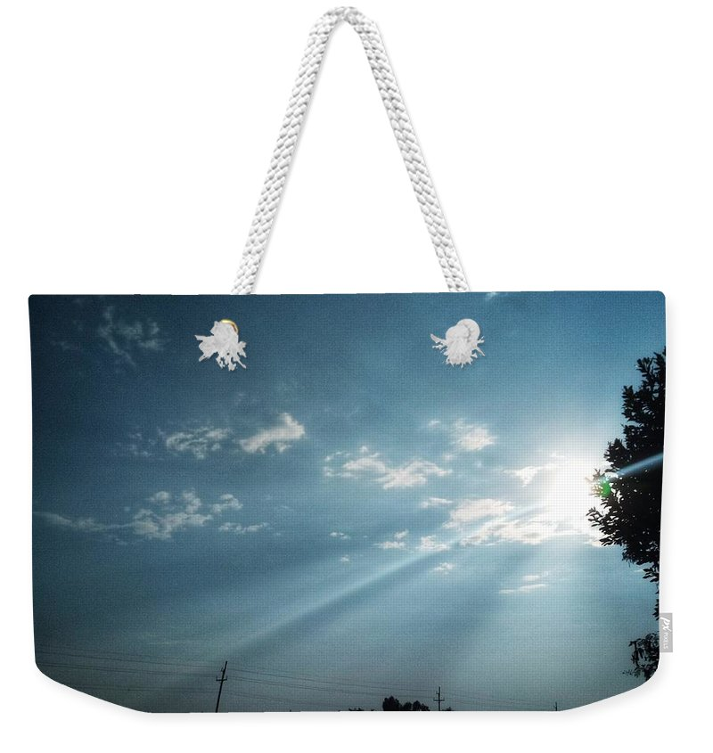 Sky Weekender Tote Bag featuring the photograph Striking rays by Yvonne's Ogolla