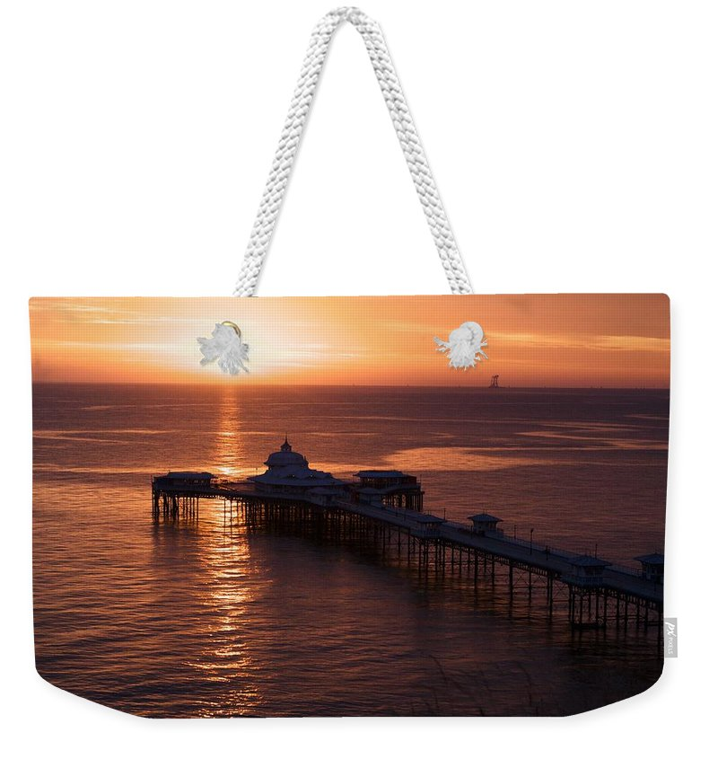 Piers Weekender Tote Bag featuring the photograph Sunrise over Llandudno pier 2 by Christopher Rowlands