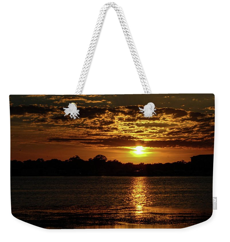 Sunset Weekender Tote Bag featuring the photograph The Sunset over the Lake by Daniel Cornell