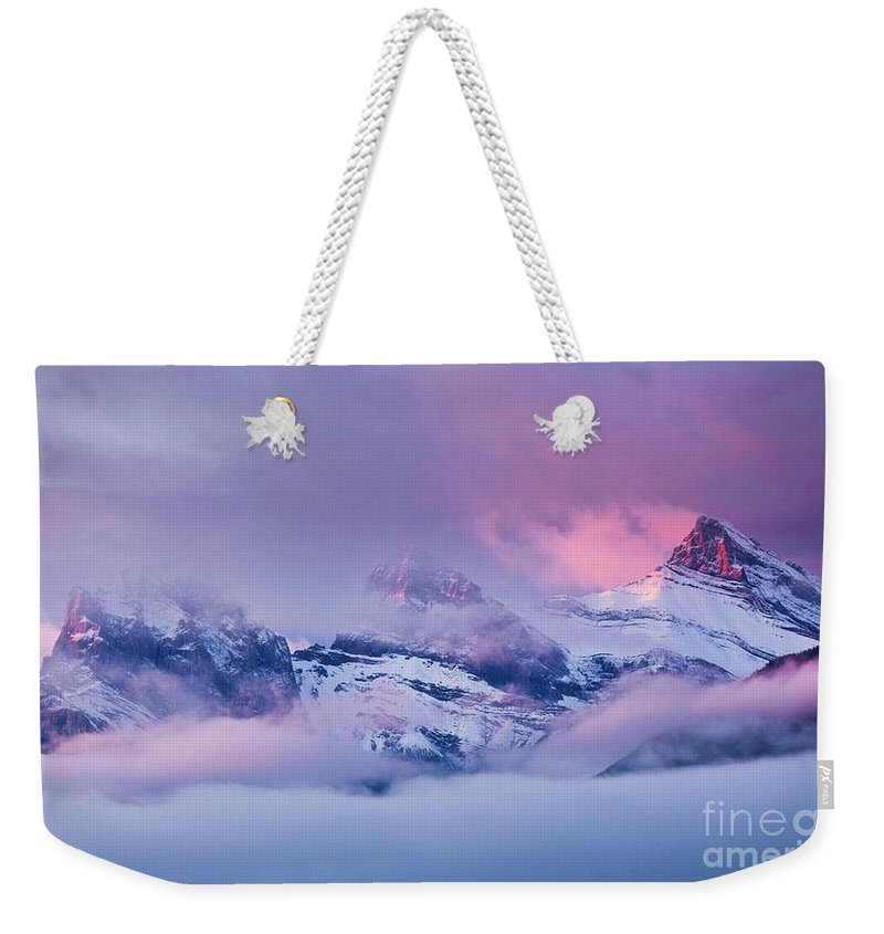 Rocky Mountains Weekender Tote Bag featuring the photograph The Three Sisters Peaks At Sunrise, Canmore, Alberta, Canada by Neale And Judith Clark