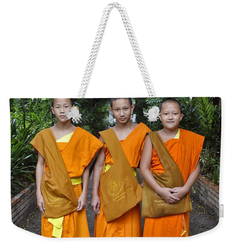 3scape Weekender Tote Bag featuring the photograph Three Young Monks by Adam Romanowicz