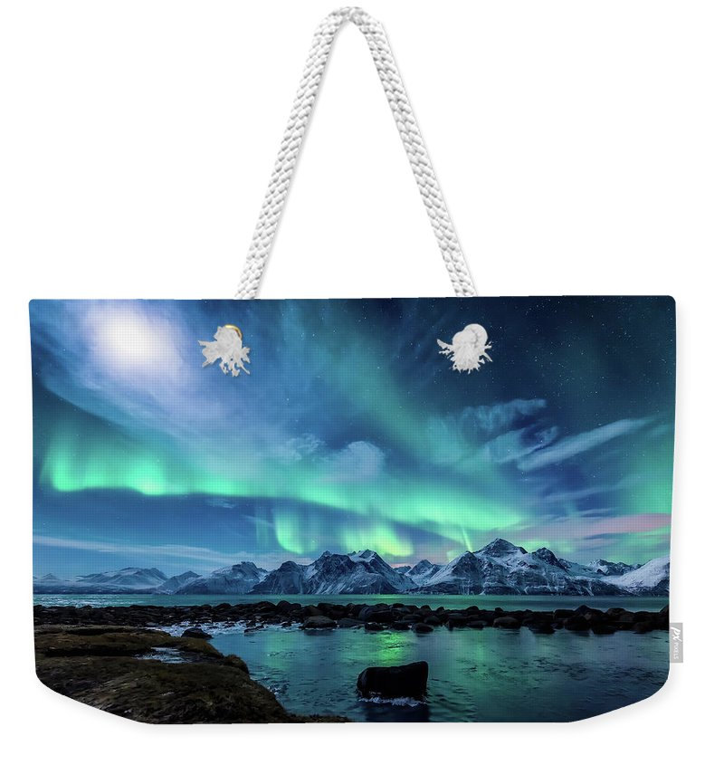 Moon Weekender Tote Bag featuring the photograph When the moon shines by Tor-Ivar Naess