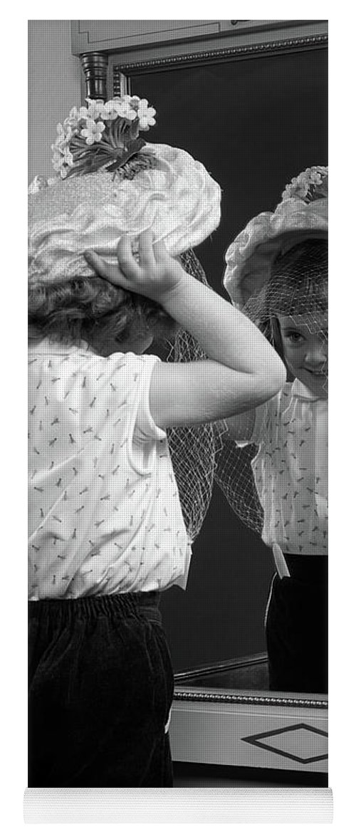 Photography Yoga Mat featuring the photograph 1950s Little Girl Trying On Hat Looking by Vintage Images