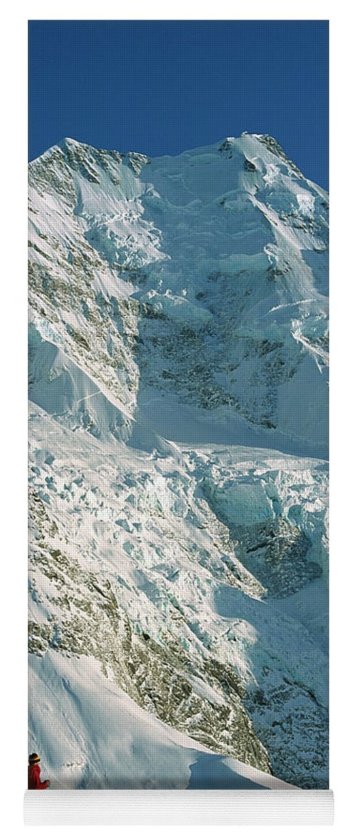 00260054 Yoga Mat featuring the photograph Climber Enjoying View Of Mt Cook by Colin Monteath