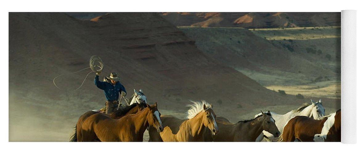 Cowboy Yoga Mat featuring the photograph Cowboy Driving Horses by John Shaw