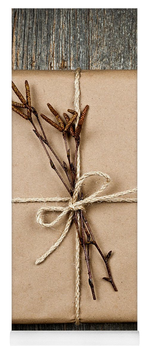 Package Yoga Mat featuring the photograph Plain Gift With Natural Decorations by Elena Elisseeva