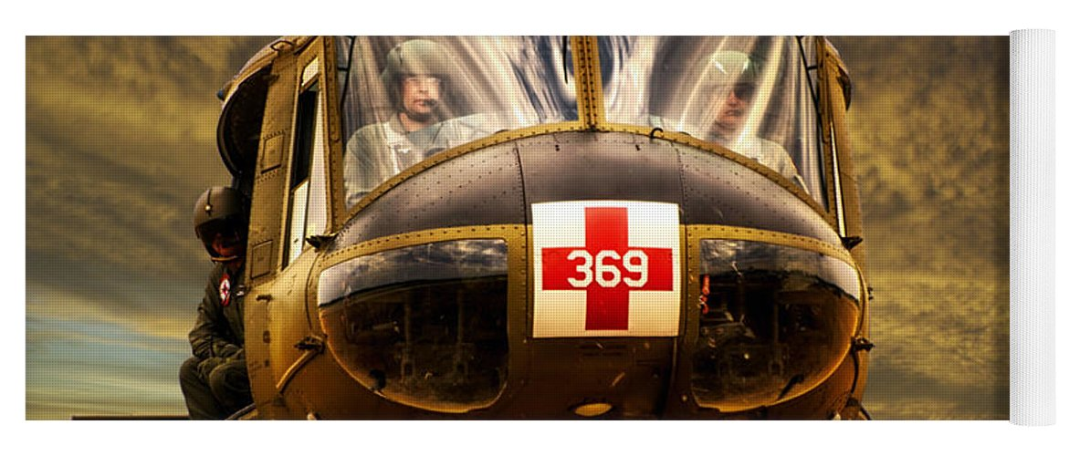Dust Off Yoga Mat featuring the photograph Vietnam Era Medivac 369 Helicopter by Thomas Woolworth