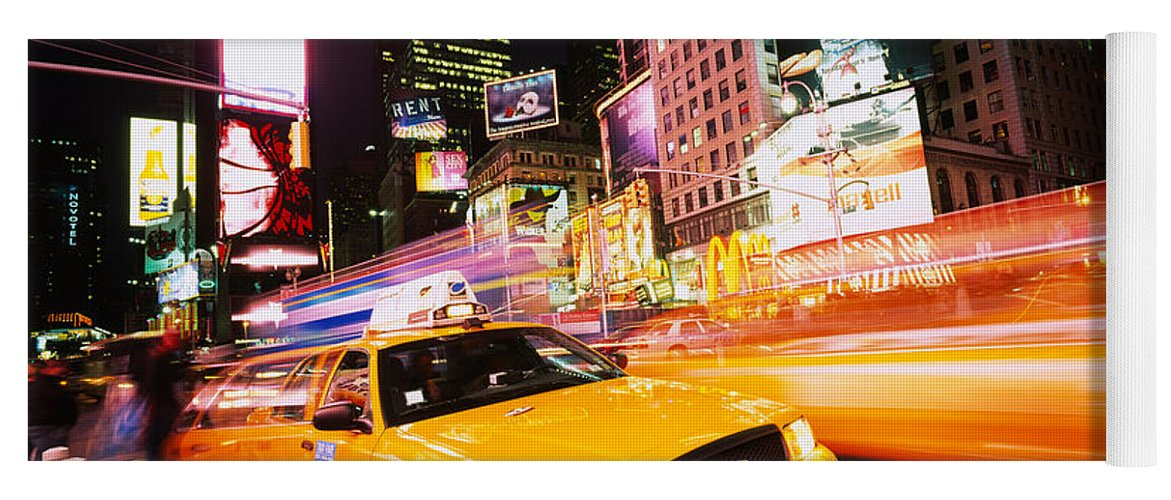 Photography Yoga Mat featuring the photograph Yellow Taxi On The Road, Times Square by Panoramic Images