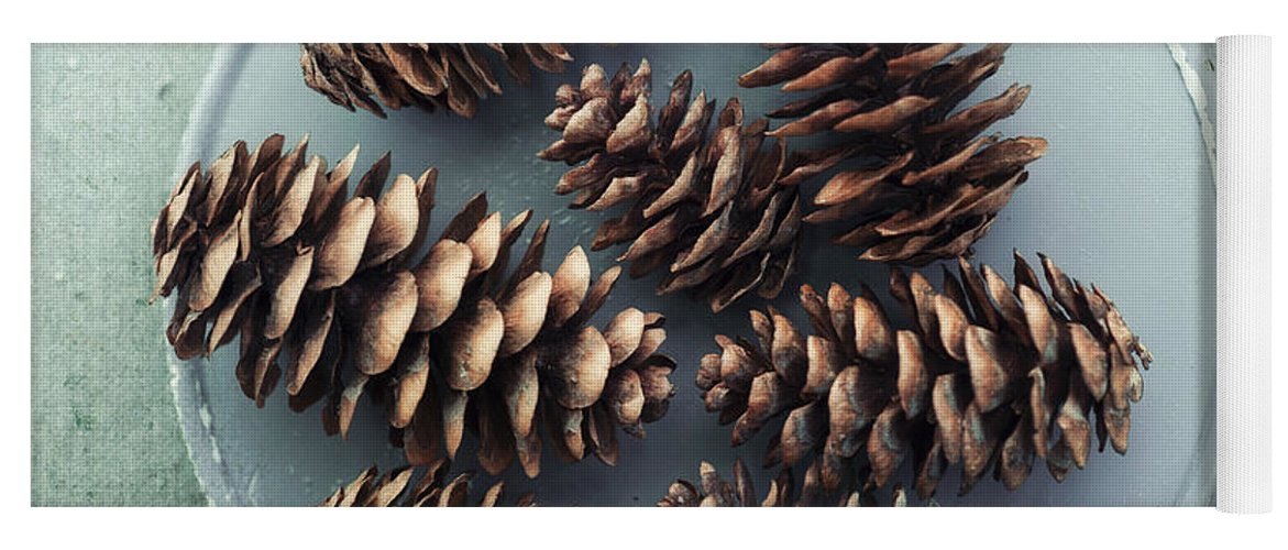 Pinecone Yoga Mat featuring the photograph Stil Life With Seven Pine Cones by Priska Wettstein