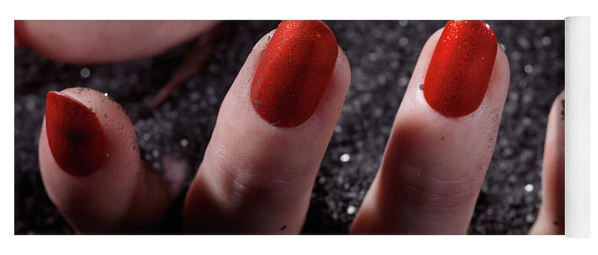Manicure Yoga Mat featuring the photograph Woman Hand With Red Nail Polish Buried In Black Sand by Oleksiy Maksymenko