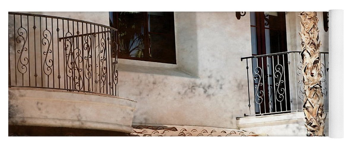 Aged Photograph Yoga Mat featuring the photograph Aged Stucco Building Balcony with Terracotta Roof by Colleen Cornelius