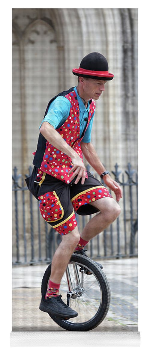 Clown Yoga Mat featuring the photograph Clown Riding Unicycle In Town by Simon Bratt Photography LRPS