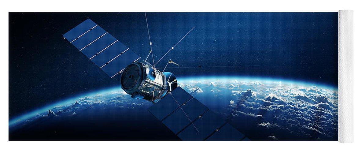 communications satellite orbiting earth yoga mat for sale by johan