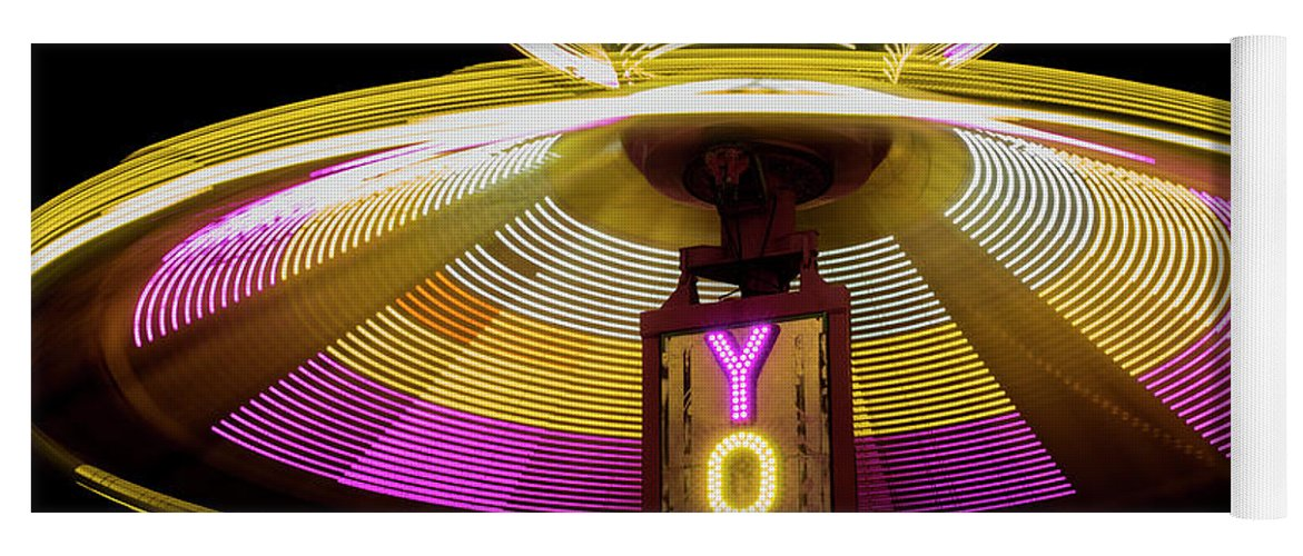 Action Yoga Mat featuring the photograph Spinning Yoyo Ride by Juli Scalzi