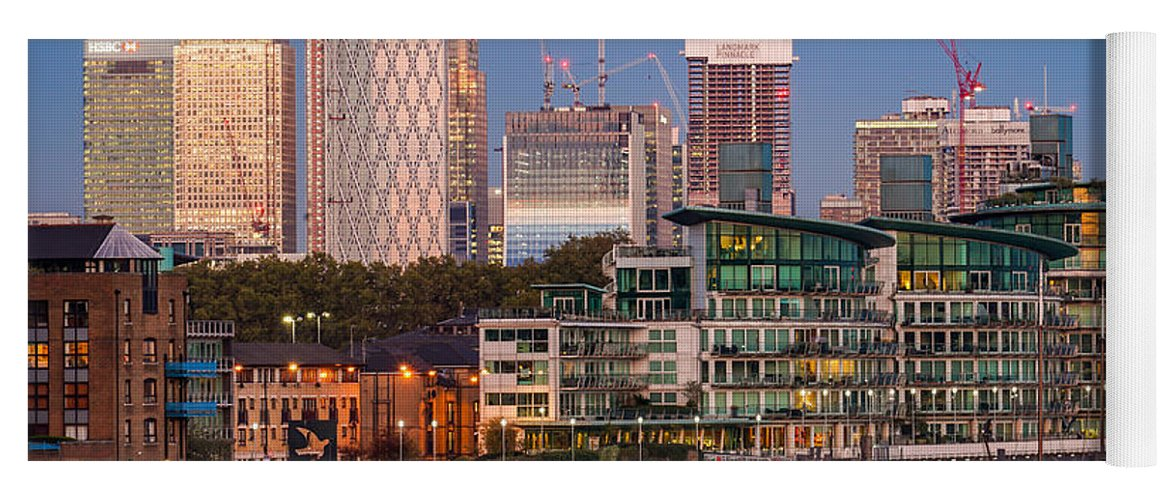London Yoga Mat featuring the photograph Canary Wharf In London, England, Seen From Tower Bridge At Blue Hour. by George Afostovremea