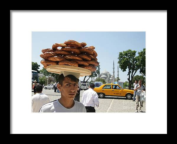 Blue Mosque Framed Print featuring the photograph Istanbul Kulouria Seller by Ros Drinkwater