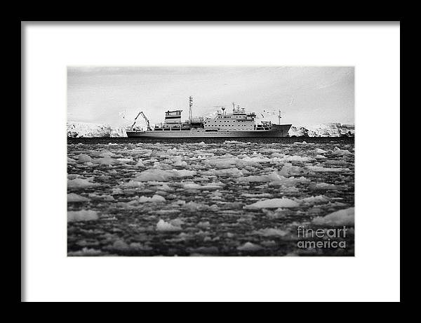 Brash Framed Print featuring the photograph Akademik Sergey Vavilov Russian Research Ship In Port Lockroy As Brash Sea Ice Forming Winter Closin by Joe Fox