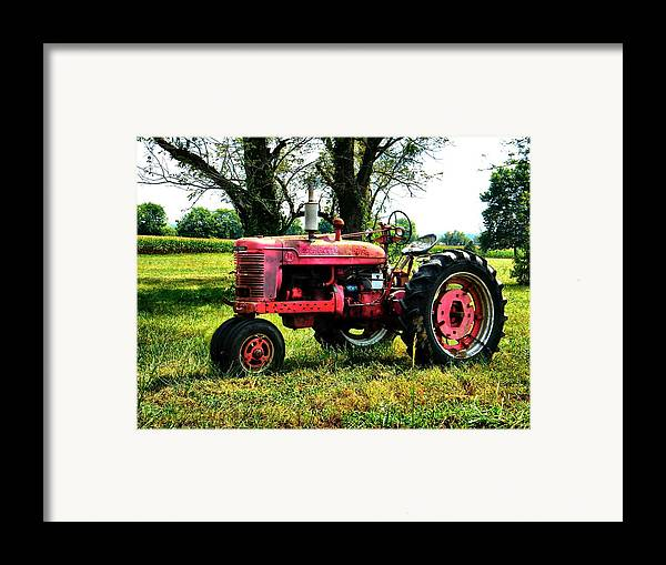 Antique Framed Print featuring the photograph Antique Tractor by Julie Dant