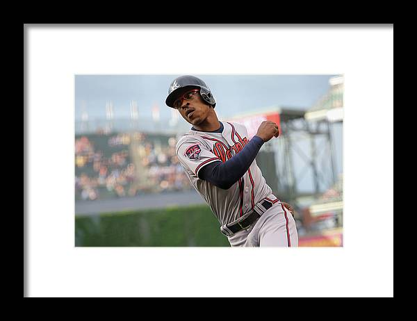 Scoring Framed Print featuring the photograph Atlanta Braves V Colorado Rockies by Doug Pensinger