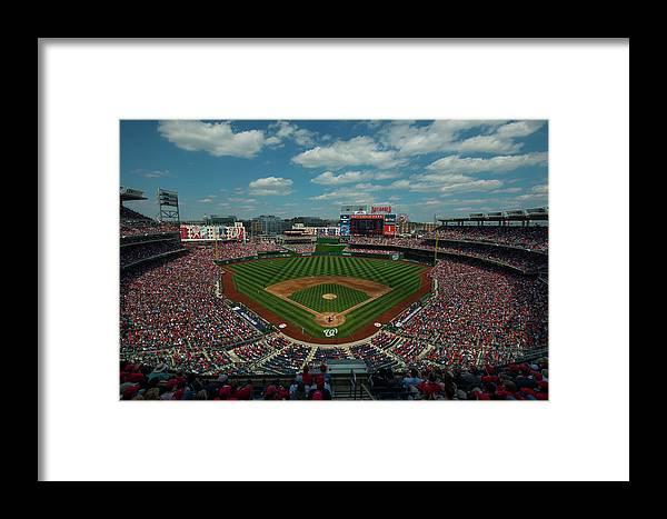 Motion Framed Print featuring the photograph Atlanta Braves V. Washington Nationals by Rob Tringali