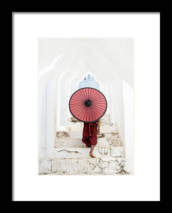 Steps Framed Print featuring the photograph Buddhist Monk Walking Along Temple by Martin Puddy