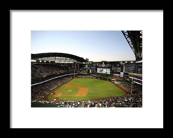 Motion Framed Print featuring the photograph Colorado Rockies V Arizona Diamondbacks by Christian Petersen