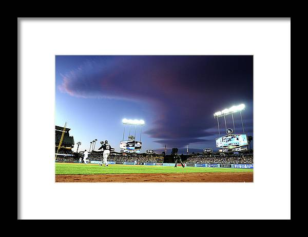 Ball Framed Print featuring the photograph Colorado Rockies V Los Angeles Dodgers by Harry How