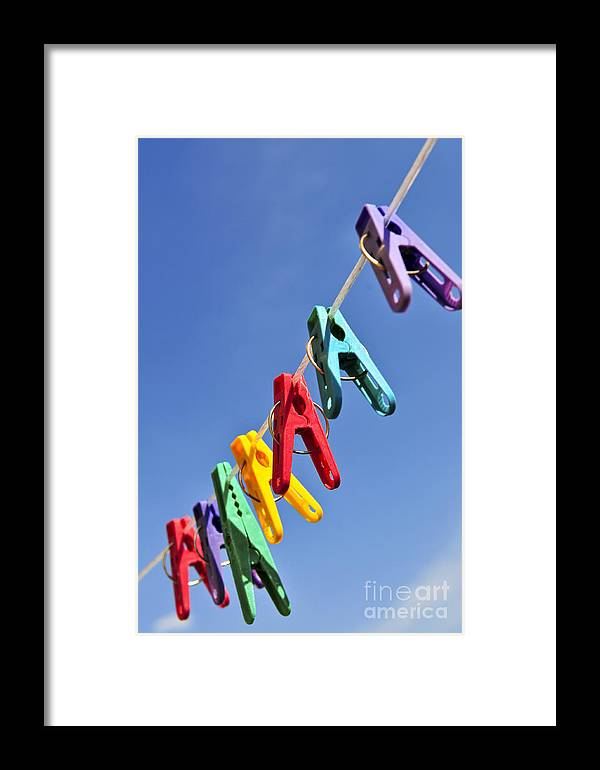 Clothes Framed Print featuring the photograph Colorful Clothes Pins by Elena Elisseeva