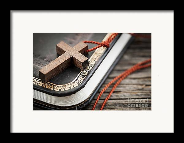 Cross Framed Print featuring the photograph Cross On Bible by Elena Elisseeva