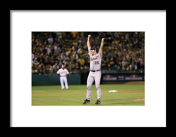 Playoffs Framed Print featuring the photograph Detroit Tigers V Oakland Athletics - 1 by Ezra Shaw