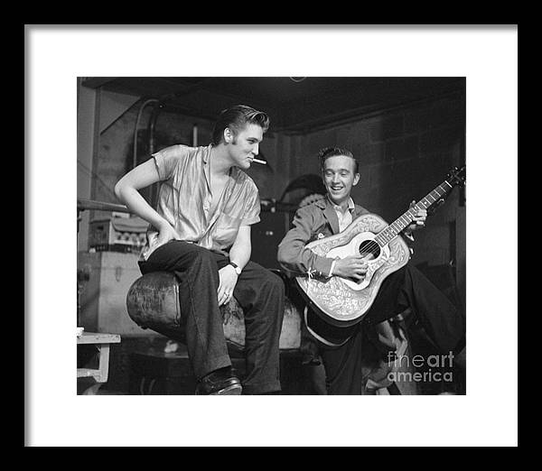 Elvis Presley Framed Print featuring the photograph Elvis Presley and his cousin Gene Smith 1956 by The Harrington Collection